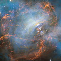 Hubble Captures The Beating Heart Of The Crab Nebula by Nasa