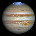 Hubble Captures Vivid Auroras In Jupiter's Atmosphere by Nasa