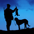 Hunter With Hare At Sunset by Arterra Picture Library