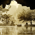 Hut In Tam Coc From A Cave River by Weston Westmoreland