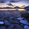 Ice Flakes Drifting Against The Sunset by Arild Heitmann