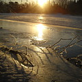 Icy Mississippi River Bank At Sunrise by Kent Lorentzen