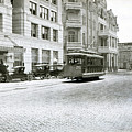 In This 1913 Photo, A Cable Car Drives Past The Littlefield Building And Dristill Hotel On Sixth Str by Austin Welcome Center