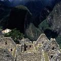 Inca Houses At Machu Picchu And Urubamba Canyon by James Brunker