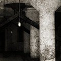 Inside Empty Dark Building With Light Bulbs Lit by Gothicrow Images