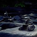 Inuksuk Stone Figures And River by Oleksiy Maksymenko