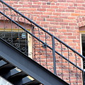 Iron Stairs On Brick Building In Colorado by Colleen Cornelius