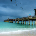 It's Getting Stormy At The Pier by Wolfgang Stocker