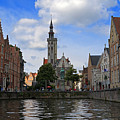 Jan Van Eyck Square With The Poortersloge From The Canal In Bruges by Louise Heusinkveld