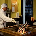 Japanese Chef In Kitchen Grills Fish On Indoor Coal Fire Tokyo Japan by Imran Ahmed
