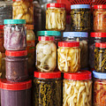 Jars Of Asian Style Pickles In Kep Market Cambodia by Jacek Malipan
