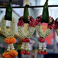 Jasmine And Rose Flower Garlands Hang With Leaves In Bazaar Hatyai Thailand by Imran Ahmed