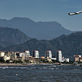 Jet Plane Taking Off From Puerto Vallarta Airport With Pacific O by Reimar Gaertner
