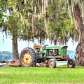 John Deer Tractor Under The Old Cedar Tree by Scott Hansen
