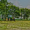 John Deere Tractor At Dusk by Jake Donaldson