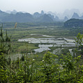 Karst Landscape Of Guangxi by Michele Burgess