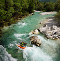 Kayaker Shooting The Cold Emerald Green Alpine Water Of The Uppe by Reimar Gaertner