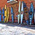 Kayaks On A Wall  by Charles Muhle