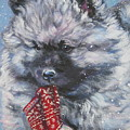 Keeshond Puppy With Christmas Stocking by Lee Ann Shepard