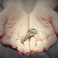 Key In Woman's Hand In Gesture Of Giving. Concept Of Success In Live, Business Solution, Real Estate Etc by Michal Bednarek