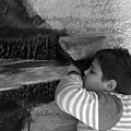 Kid Drinking From The Fountain by Munir Alawi