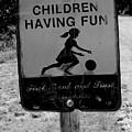 Kids At Play Sign by Robert Wilder Jr