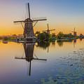 Kinderdijk At Sunset by Christian Tuk