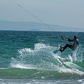 Kite Surfer Jumping Over A Wave by Sami Sarkis
