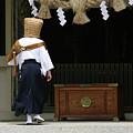 Komuso At The Shrine by Masami Iida