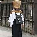 Komuso In The Street by Masami Iida