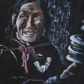 Ladakhi Woman Spinning A Prayer Wheel by Samanvitha Rao