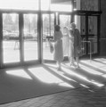 Ladies Leaving The Mall  by Lyle Crump