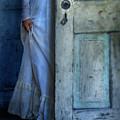Lady In Vintage Clothing Hiding Behind Old Door by Jill Battaglia