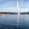 Lake Geneva Switzerland With Water Fountain And Water Taxi On A  by Thomas Baker