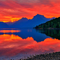 Lake Mcdonald Fiery Sunrise by Greg Norrell