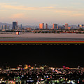 Las Vegas Skyline At Dawn And At Night by Carl Deaville