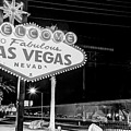 Las Vegas Welcome Sign Lights In Black And White by Gregory Ballos