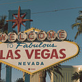 Las Vegas Welcome Sign With Vegas Strip In Background by Alex Grichenko