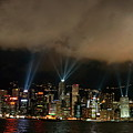 Laser Show Over City At Night by Sami Sarkis