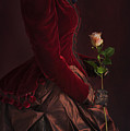 Late Victorian Woman In A Crimson Velvet Jacket And Dress Holdin by Lee Avison