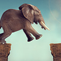 Leap Of Faith Concept Elephant Jumping Across A Crevasse by Lee Avison