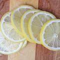 Lemon Slices On Cutting Board by Edward Fielding