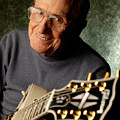 Les Paul With His White Gibson Les Paul Custom Guitar By Gene Martin by David Smith