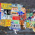 License Plate Map Of The Usa On Gray Distressed Wood Boards by Design Turnpike