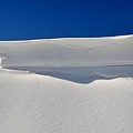 Light And Shadow On The Snow  by Lyle Crump