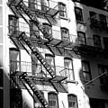 Light Falls On Greenwich Village In New York City by John Rizzuto