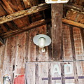 Light Hanging Inside An Old Wooden Hut by Sami Sarkis
