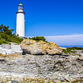 Lighthouse And Rocks by Roberta Bragan