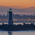 Lighthouse And Wharf At Dusk by Bruce Frye