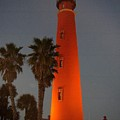Lighthouse At Sunset by Larry Waller